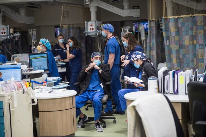 Medical personnel work in the crowded temporary PACU ICU at the Augusta University Medical Center in Augusta, Ga., Thursday afternoon January 14, 2021.