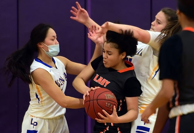 Lincoln Park's Jocelyn Herda, left, and Aizlyn Thompson, second from right, close in on Beaver Falls' Sincere Conley, center, during a game earlier this season. Beaver Falls beat Waynesburg Central Saturday to advance to the WPIAL Class 3A semifinals for the first time since 2010-11.