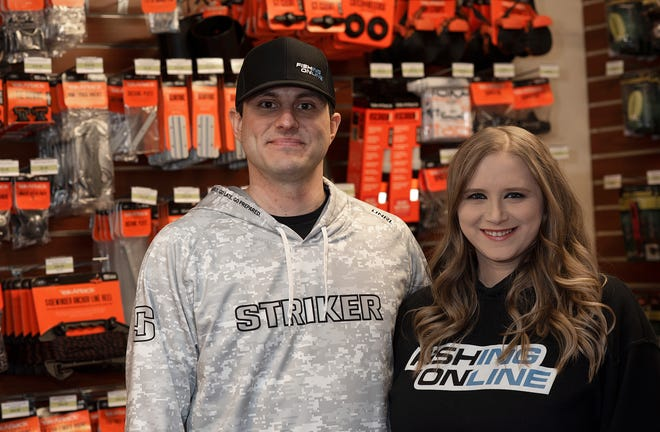 John and Brienne Harley, shown Wednesday in their Fallston store, Fishing Online, is the main sponsor for top fishing pro Dave Lefebre.