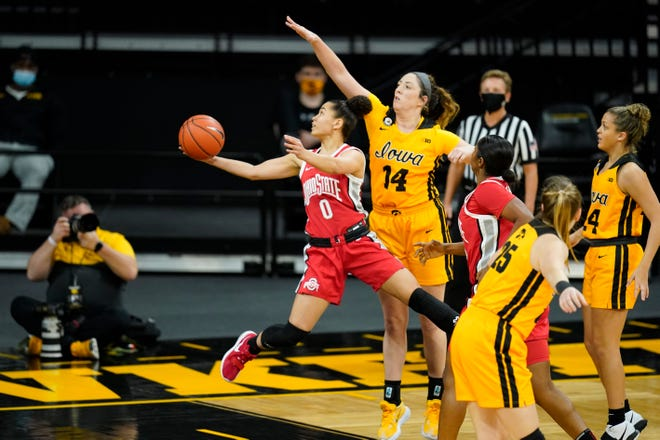 Ohio State guard Madison Greene drives to the basket past Iowa guard McKenna Warnock (14) during the first half. Greene finished with 20 points.