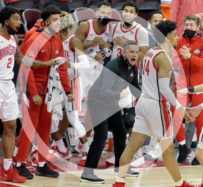 In this file photo, The Ohio State Buckeye bench players cheer after forward Justice Sueing (14) made a three-point shot late in the second half of Wednesday's NCAA Division I basketball game against the Northwestern Wildcats at Value City Arena in Columbus, Oh., on Wednesday, January 13, 2021. Ohio State won the game 81-71.