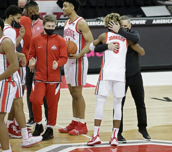 Ohio State coach Chris Holtmann hugs freshman guard Meechie Johnson Jr. following the Buckeyes' 81-71 won over Northwestern on Wednesday. Johnson made his home debut with six points in 11 minutes.