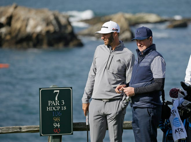 Dustin Johnson, left, and Wayne Gretzky stand on the seventh tee of the Pebble Beach Golf Links during the  AT&T Pebble Beach Pro-Am golf tournament in February 2019 in Pebble Beach, Calif. The Feb. 11-14 tournament will not have celebrities for the first time because of the COVID-19 pandemic.