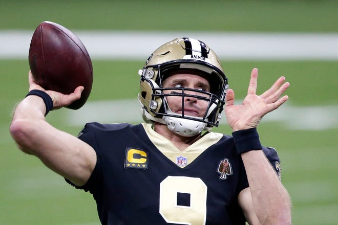 New Orleans Saints quarterback Drew Brees (9) warms up before an NFL wild-card playoff game against the Chicago Bears on Sunday in New Orleans.