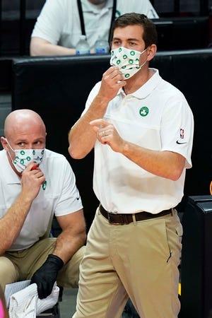 Boston Celtics head coach Brad Stevens gestures during a Jan. 6 game against the Miami Heat in Miami.
