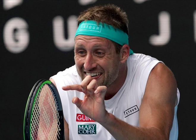 Tennys Sandgren of the U.S. reacts after losing a point to Switzerland's Roger Federer during their quarterfinal match at the 2020 Australian Open tennis championship in Melbourne, Australia.