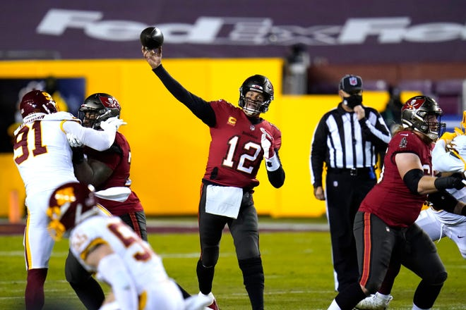 Tampa Bay Buccaneers quarterback Tom Brady passes against the Washington Football Team during Saturday's NFL wild-card playoff game in Landover, Md.