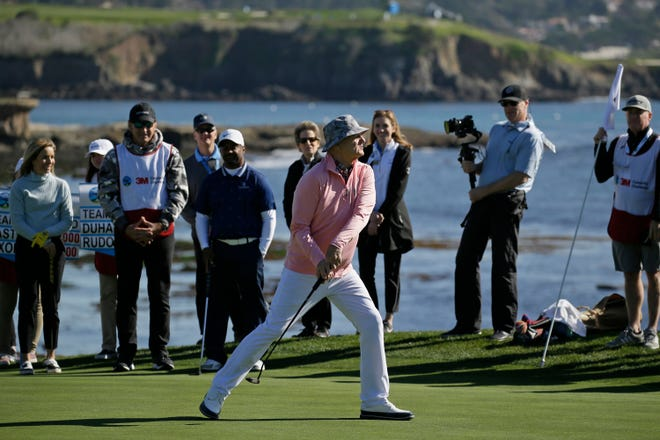 Bill Murray tosses his putter into a bunker after missing a birdie putt during the celebrity challenge event of the AT&T Pebble Beach National Pro-Am golf tournament on the Pebble Beach Golf Links in Pebble Beach, Calif., in February 2020.