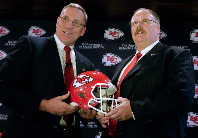 Kansas City Chiefs general manager John Dorsey, left, poses with head coach Andy Reid during a news conference Jan. 14, 2013, in Kansas City.