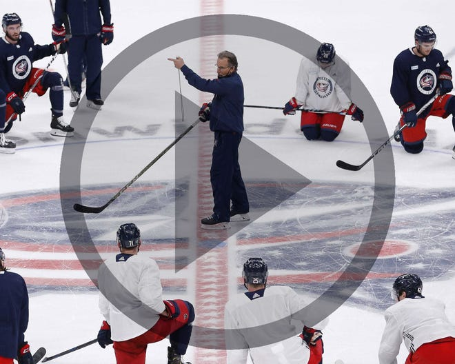 In this file photo, Blue Jackets coach John Tortorella, center, knows his team will have to be flexible and resilient this season in the face of NHL protocols relating to COVID-19, which prevented 17 of his players from practicing on Friday.