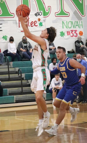 Barnesville's Colton Hines gets past Steubenville Catholic's Ryan Gorman for two of his 16 points during Wednesday night's game in Barnesville.