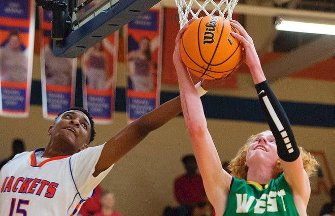 West Davidson's Macon Stovall, shown here muscling down a rebound against Lexington's Micah Williams in a game played last season, is off to a fast start in the 2021 season.  [DONNIE ROBERTS/THE DISPATCH]