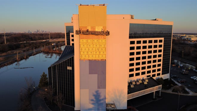 A subcontracted crew with Millcreek Township-based Amerail Systems Inc. performs exterior renovation work on the 12-story Renaissance Airport Hotel In Philadelphia in early January.