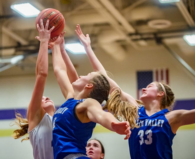 Grain Valley's Gabbi Keim, center, and Grace Slaughter, right, battle Notre Dame de Sion's Olivia Shively for a rebound under the basket during their Pleasant Hill Tournament semifinal Wednesday. Grain Valley rallied for a 58-46 win and a berth in Friday's championship.
