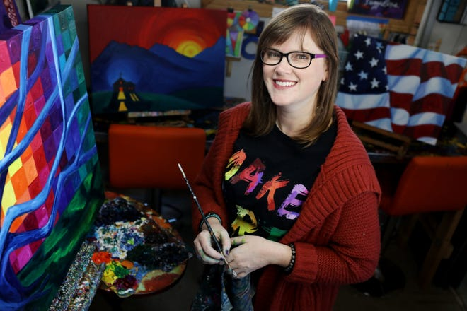 """Artist Annie Guldberg, next to a recently commissioned painting titled """"The Banyan Tree"""" Monday Jan. 11, 2021 in her Mount Pleasant studio."""