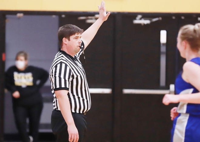 Nathan Carlson of Winfield, a former girls basketball coach at Columbus, is in his seventh year of officiating high school basketball games.