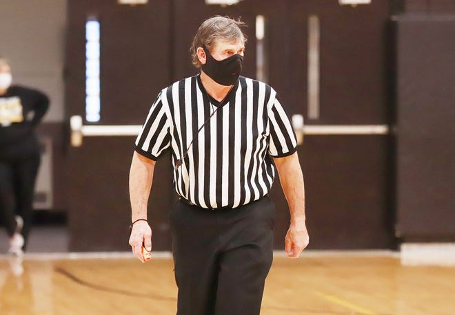 Jim Carlson, a farmer in the Winfield area,  has officiated high school basketball games for over 40 years, the last seven with his son, Nathan.