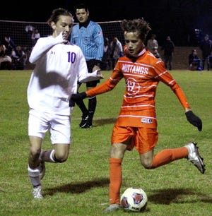 Mandarin midfielder Adis Mesic (12) prepares a pass as Fletcher midfielder Brian Bradley (10) defends during a Gateway Conference high school boys soccer semifinal on January 13, 2021. [Clayton Freeman/Florida Times-Union]