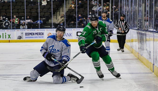 Jacksonville Icemen forward Derek Lodermeier (16), left and Florida Everblades forward John McCarron (25) vie for the puck during a December game. The teams' scheduled weekend series was postponed due to COVID-19.