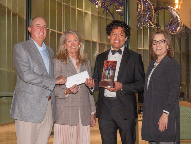 Jorge Pena (second from right), artistic director of the St. Augustine Music Festival and violist with the Jacksonville Symphony, receives the Ann McDonald Baker Art Ventures Award from The Community Foundation of Northeast Florida. Tom Baker, advisor to the Baker Family Advised Fund, Martha Frye Baker (second from left), chair of the board of trustees for foundation, and Nina Waters, foundation president, participated in the presentation.
