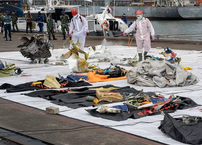 The National Transportation Safety Committee shows evidence of debris from the Sriwijaya Air plane that crashed at Tanjung Priok Port on Jan. 11, 2021, in Jakarta, Indonesia.