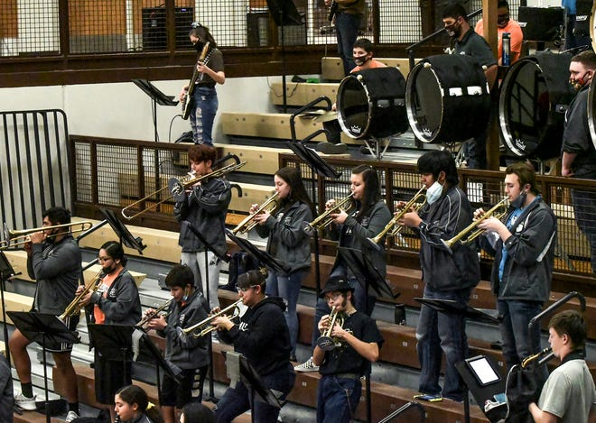 Garden City High School's pep band fills a portion of the stands Tuesday night in th GCHS gym, performing during the home opening basketball games. The crowd at the games was smaller, mainly parents, with COVID-19 protocol in place.