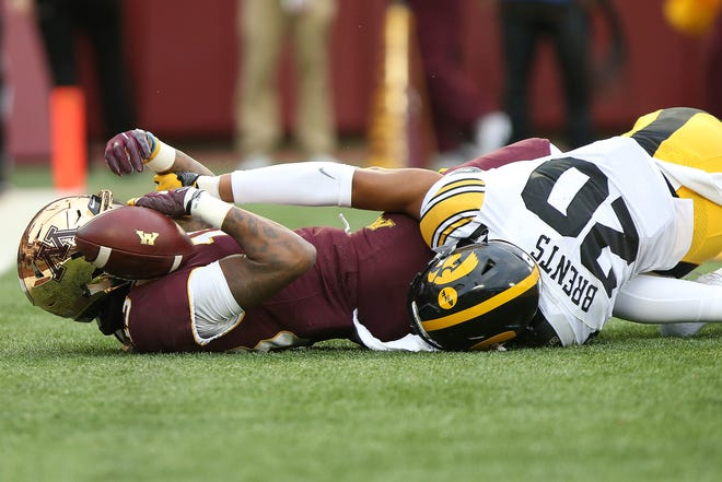 Minnesota wide receiver Rashod Bateman holds onto the ball in end zone after scoring a touchdown against Iowa's Julius Brents during a game on Saturday, Oct. 6, 2018, in Minneapolis.