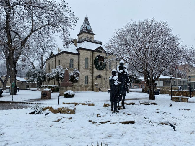 The Historic Courthouse in the Downtown Square in Glen Rose is covered in white after the snowstorm that hit the area Saturday and Sunday.