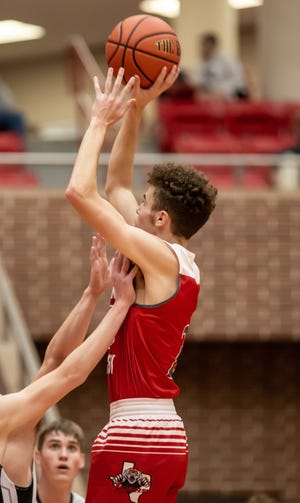 Glen Rose's Caden Schinagel gets fouls as he goes up for a jumper in a game against Graford earlier in the season.