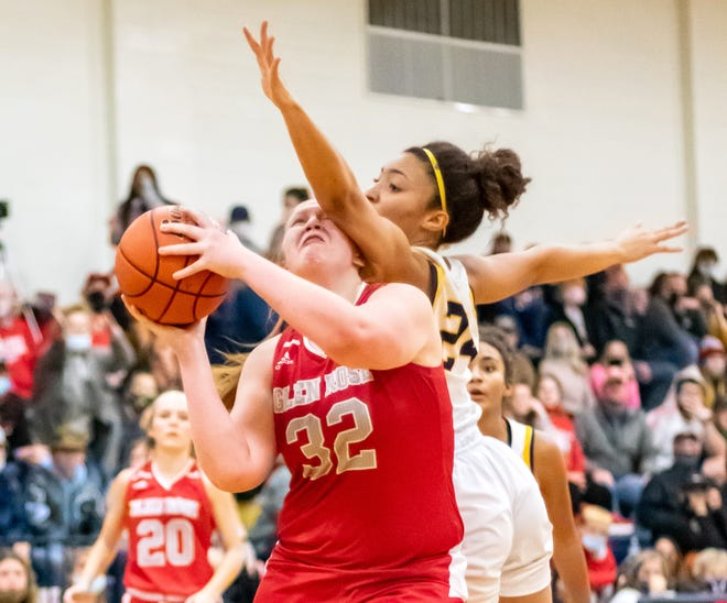 Glen Rose's Jean Douglas gets fouls as she goes to the basket against Stephenville on Friday night. She scored 15 points in a 40-34 loss to the Honeybees.