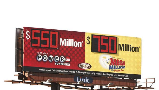 A billboard advertises the jackpots of the Powerball and Mega Millions lotteries, in Omaha, Neb., Wednesday, Jan. 13, 2021.
