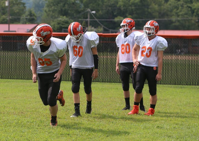 Rosman High football players go through drills during practice last season at Rosman.