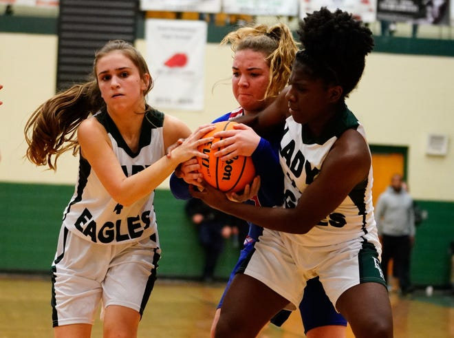 East Henderson's Sontee Moore, right, and teammate Emma Gilliam fight for a ball against West Henderson's Bailey Swayngim during a game last year at East.