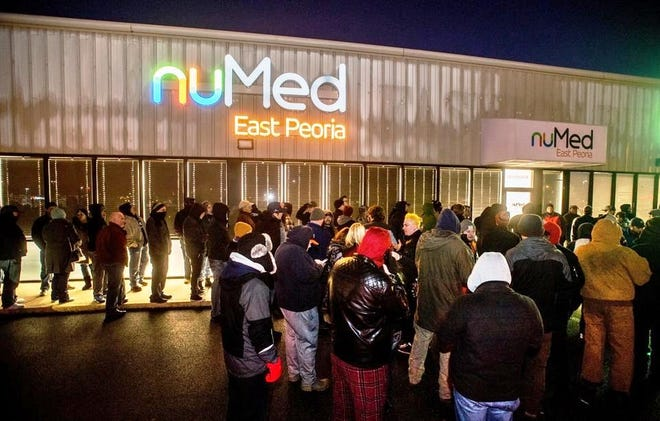 Patrons line up outside the NuMed marijuana dispensary before recreational sales began on the first day they were legal in Illinois, Jan. 1, 2020. NuMed now is known as NuEra Cannabis, which wants to open another dispensary, this one in North Peoria.
