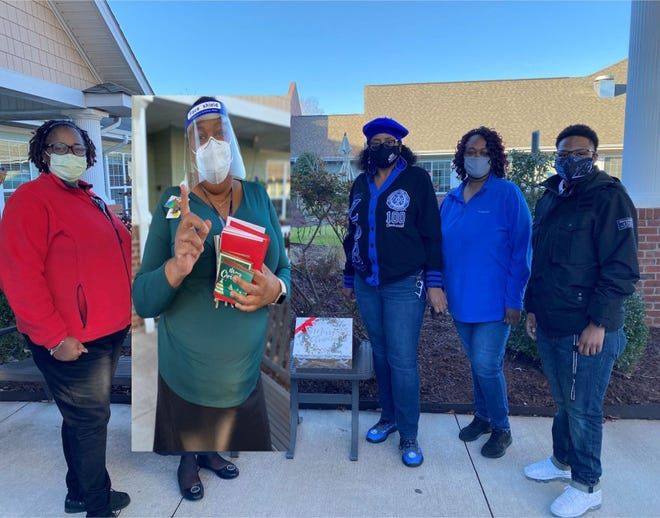 Zeta Phi Beta Sorority Inc. and Delta Rho Zeta recently provided one hundred Christmas cards to the local Veteran's Home in Kinston. Each veteran received a card and two dollars. Pictured, Kimberly Dixon, VA Home recreation director, community membersCheryl Thompson, Felicia Wooten, and Valarie Walker, and Courtney Sutton. [CONTRIBUTED PHOTO]