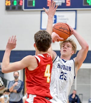 Hudson's Tyler Miller puts up a shot over Brecksville-Broadview Heights' Eli Skajac during the Explorers' home loss to the Bees Tuesday.