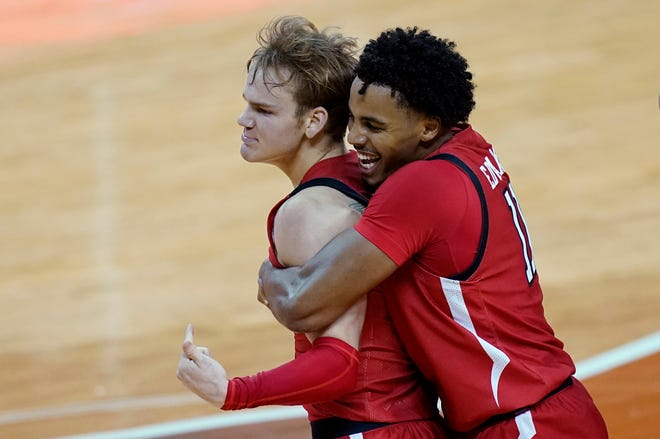 Texas Tech guard Mac McClung (0) is grabbed by guard Kyler Edwards (11) as they celebrate McClung's winning basket in the final seconds of a Big 12 Conference game Wednesday against Texas at the Frank Erwin Center in Austin. McClung finished with a game-best 22 points, while Edwards chipped in seven points, and made a steal to help knot the game up before the No. 15 Red Raiders defeated the No. 4 Longhorns 79-77. [AP Photo/Eric Gay]