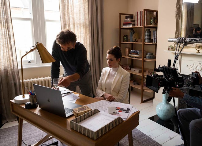 """This image released by HBO Max shows director Doug Liman, left, with actress Anne Hathaway on the set of """"Locked Down."""" In four months, in the middle of a pandemic and widespread shutdowns, Liman and his team wrote, shot and edited a glossy Harrods heist film in London with Hathaway and Chiwetel Ejiofor. The result, """"Locked Down,"""" premiered on HBO Max Thursday."""