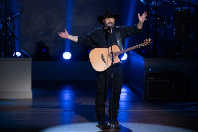 In this March 4, 2020, file photo, Garth Brooks performs on stage during the 2020 Gershwin Prize Honoree's Tribute Concert at the DAR Constitution Hall in Washington.