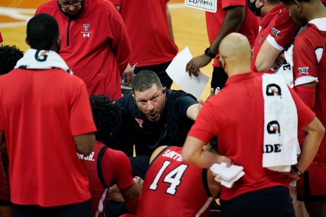 Texas Tech coach Chris Beard, center, talks with his team during the first half of a Big 12 Conference game Wednesday against Texas at the Frank Erwin Center in Austin. The No. 15 Red Raiders earned a 79-77 win over the No. 4 Longhorns. [AP Photo/Eric Gay]