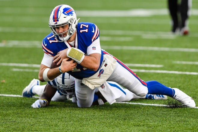 Buffalo Bills quarterback Josh Allen (17) is tackled by Indianapolis Colts' Kenny Moore II during the second half of an NFL wild-card playoff football game Saturday, Jan. 9, 2021, in Orchard Park, N.Y.