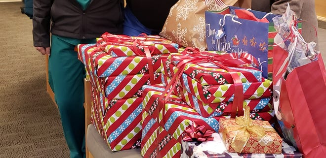 Shortly before Christmas, the Victor-Farmington Rotary Club continued its annual tradition of providing gifts for newborns and new moms in the Birthing Center at UR Medicine Thompson Hospital. Pictured with the gifts, from left, are staff members Amanda DeWispelaere, Melissa Hoffman and Susan Tufts.