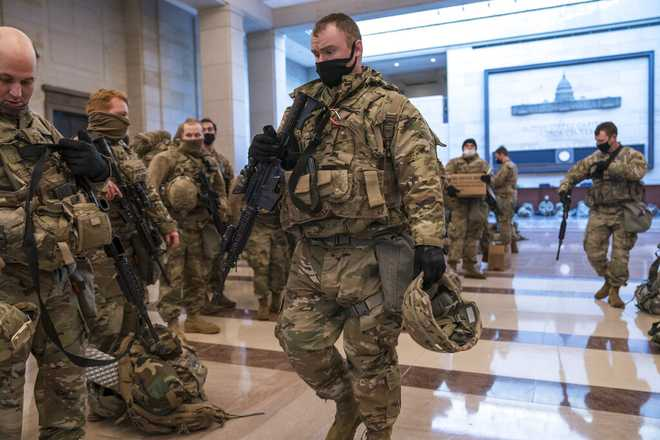 Hundreds of National Guard troops were inside the Capitol Visitor's Center to reinforce security at the Capitol in Washington, Wednesday, Jan. 13, 2021. Gov. Charlie Baker said he would send 500 Guard members from Massachusetts to help with security during Joe Biden's inauguration on Wednesday.