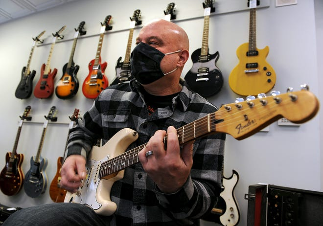 Bill Phaneuf at his music store, Guitars & Grooves, Jan. 14, 2021, which just opened at 19A Main St. in the traffic circle in downtown Hudson.