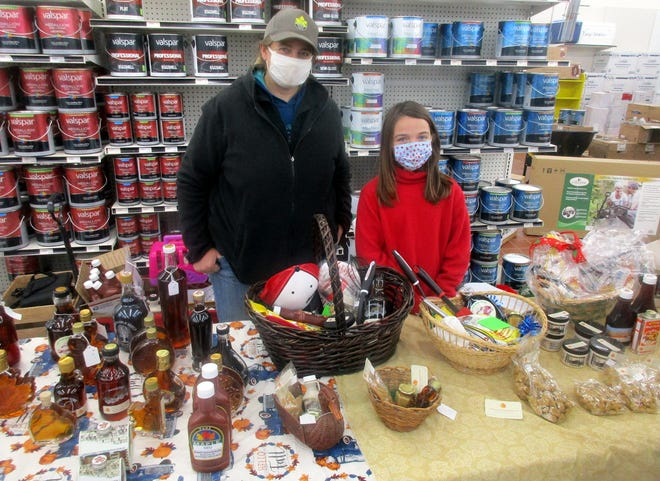Andrea, left, and Maranda Schmidt pose Nov. 21 at their Schmidt's Scattered Maple booth at Parry's Indoor Farmers Market at Parry's General Store in Hamilton. They are in their fourth year selling maple products there.