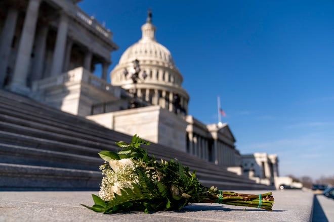 The Dome of the Capitol Building is visible as flowers lie on the steps to the House Chamber on Capitol Hill in Washington, Wednesday, Jan. 13, 2021. (AP Photo/Andrew Harnik)