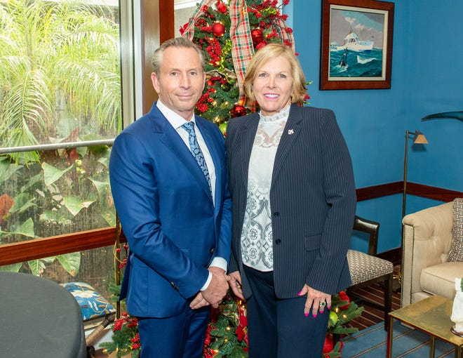 J.B. Edwards and Karen Donnelly posed in 2019 at the Sailfish Club of Florida during a holiday luncheon sponsored by the Palm Beach Board of Realtors. Donnelly was recently installed as president of the real estate group, with Edwards assuming the title immediate past president.
