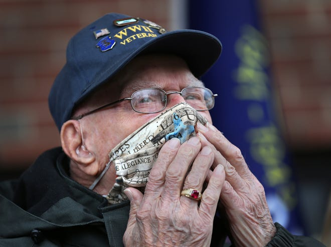 WWII veteran Ray Goulet gives an emotional kiss to the crowd gathered to celebrate his 98th birthday at Portsmouth's Margeson Apartments Thursday, Jan.14, 2021. Goulet was among the first wave of soldiers to storm Omaha Beach in Normandy, France, on D-Day in 1944.