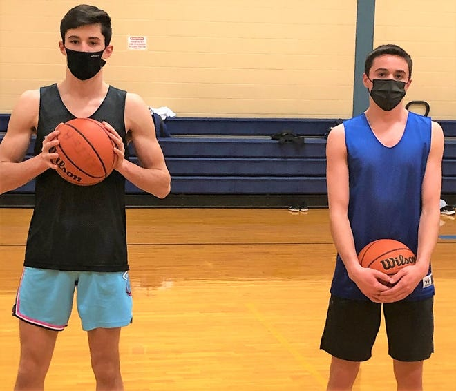 Seniors Jacob Gibbons, left, and Matt McConnell are the captains of this year's Exeter High School boys basketball team.