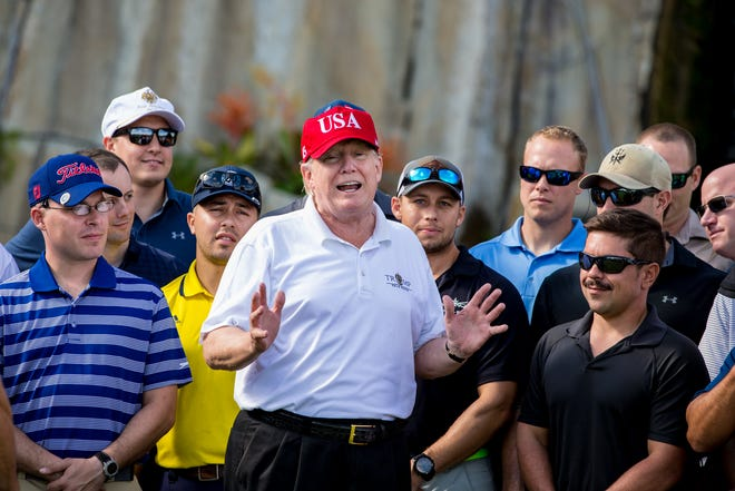President Donald Trump welcomes members of the U.S. Coast Guard to a tournament and lunch at the Trump International Golf Club in Palm Beach on Thursday, December 29, 2017.